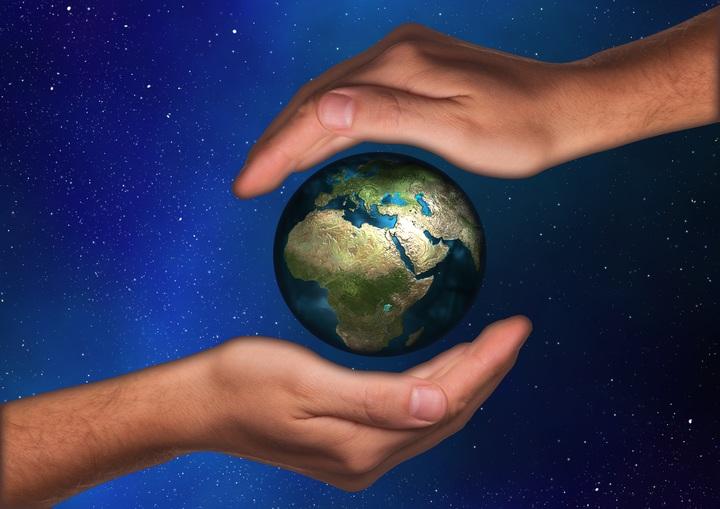 hand-sky-reflection-space-blue-globe-1093799-pxhere-com.jpg