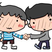 仲良く握手する2人の男の子