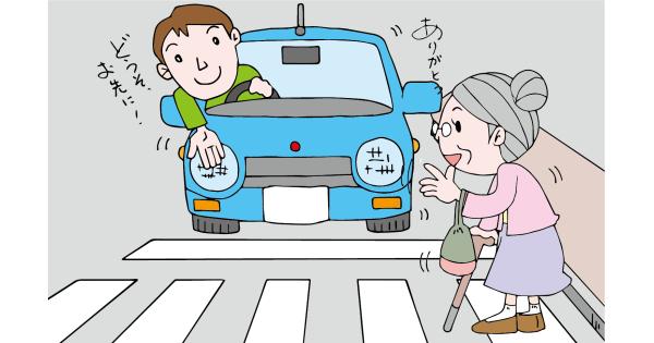 横断歩道でおばあさんに道を譲る男性ドライバー